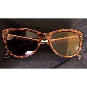 GUCCI sunglasses.